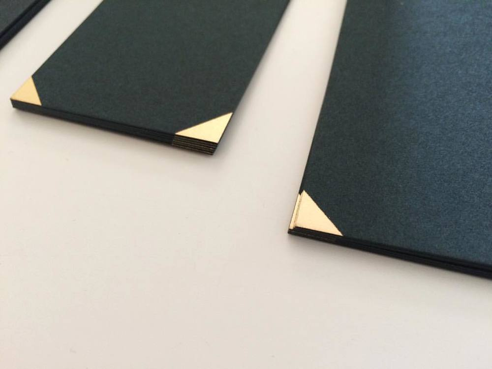 Gold foil corner details on dark green Gift Tags #studio #details #decorativepaper #esmewinter #packing #christmas2015 #gifttags #giftwrap