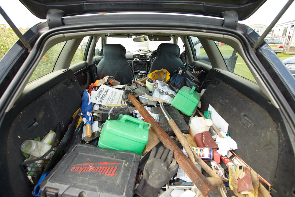 Take the challenge....clean out Tom's car