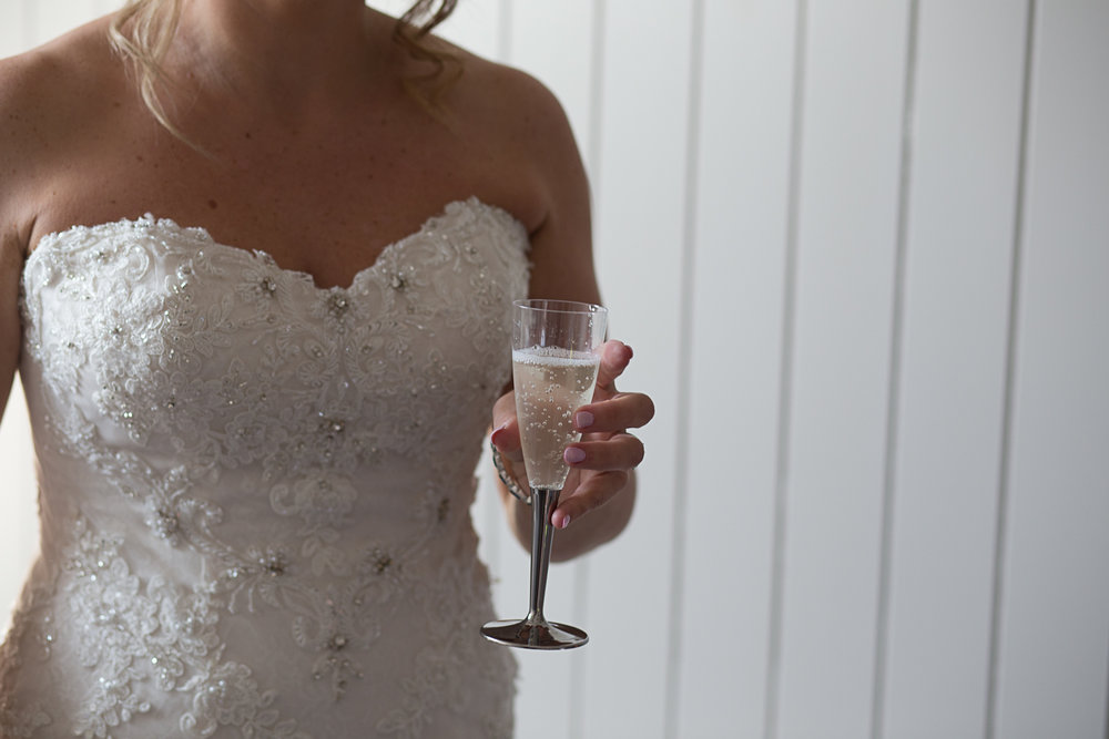 champagne, bride drinking champagne, wedding photographer in Scotland