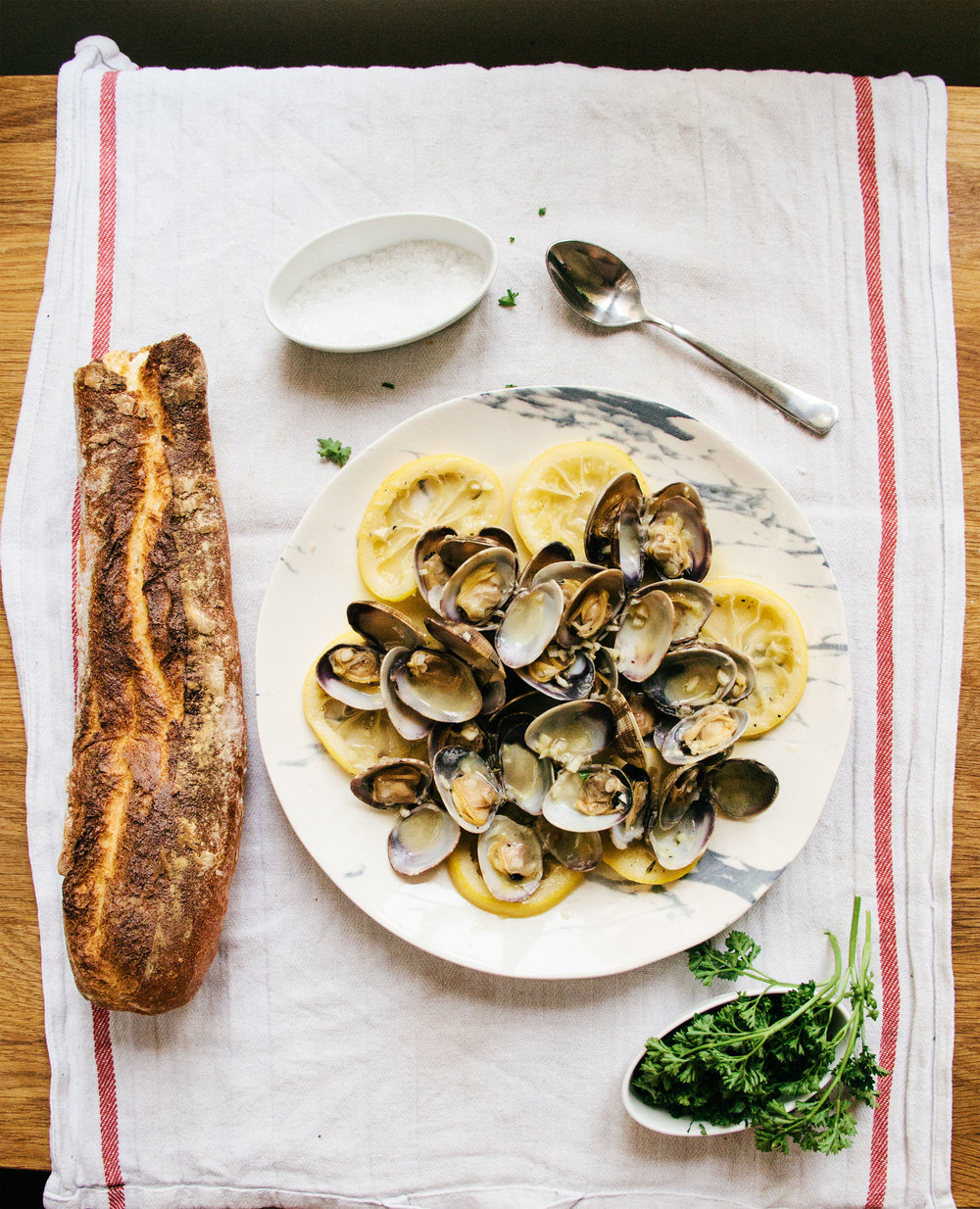 Manila Clams with White Wine, Breton Butter, and Lemon Slices
