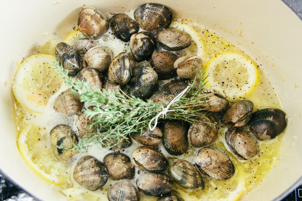 Manila clams with lemons Breton butter white wine