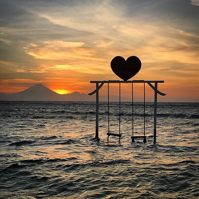 The sunset on Gili T with a couple's swing.
