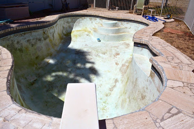 Diving Board over an Empty Pool