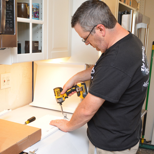 IKEA-cabinet-Assembly_with_impact_driver.jpg