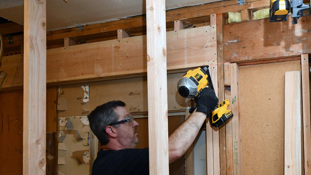 11-framing-with-a-cordless-nail-gun.jpg
