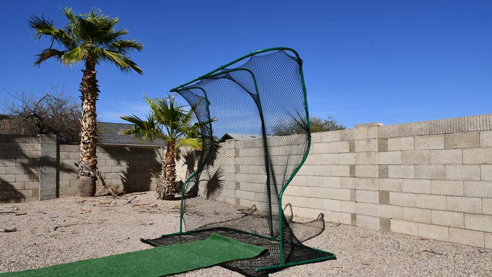 The golf net with a roll of fresh lawn.