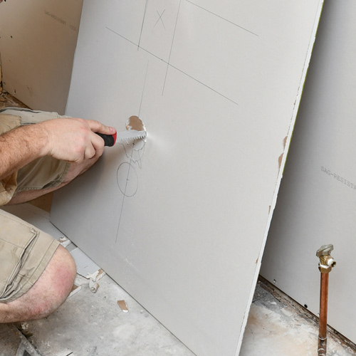 8-drywall-cutting-with-saw.jpg