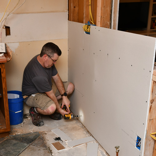 8-drywall-screwing-with-dewalt-impact-driver.jpg