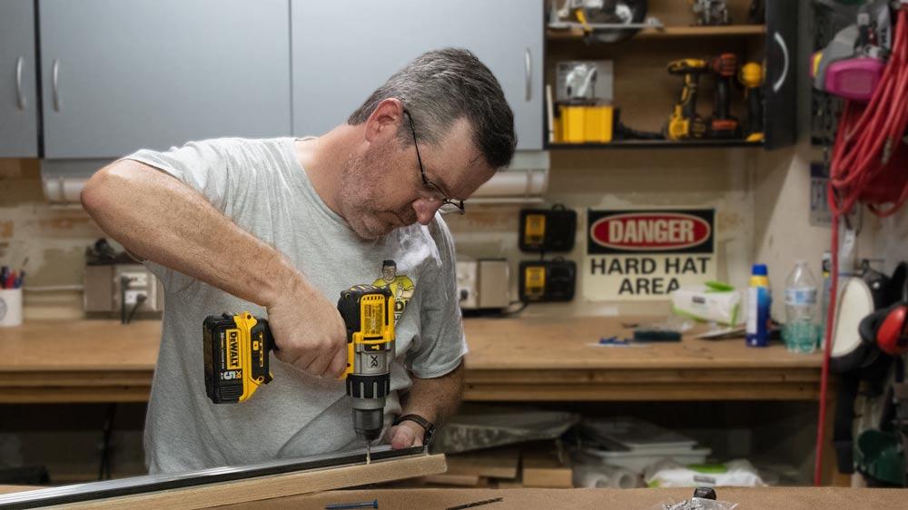 Drill:   DeWalt 3-Speed Cordless Hammer-drill   Bits:   DeWalt Titanium