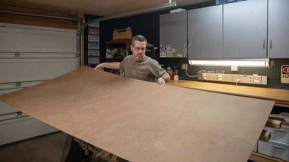 "Man-handling a 4x8 sheet of 1/8"" hardboard"