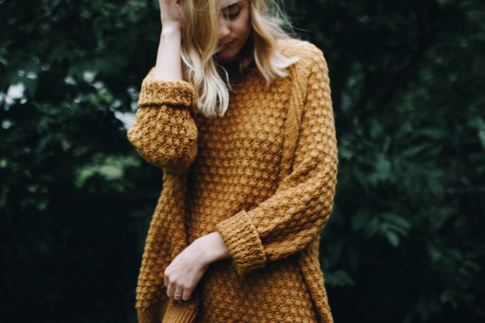 yellow sweater -