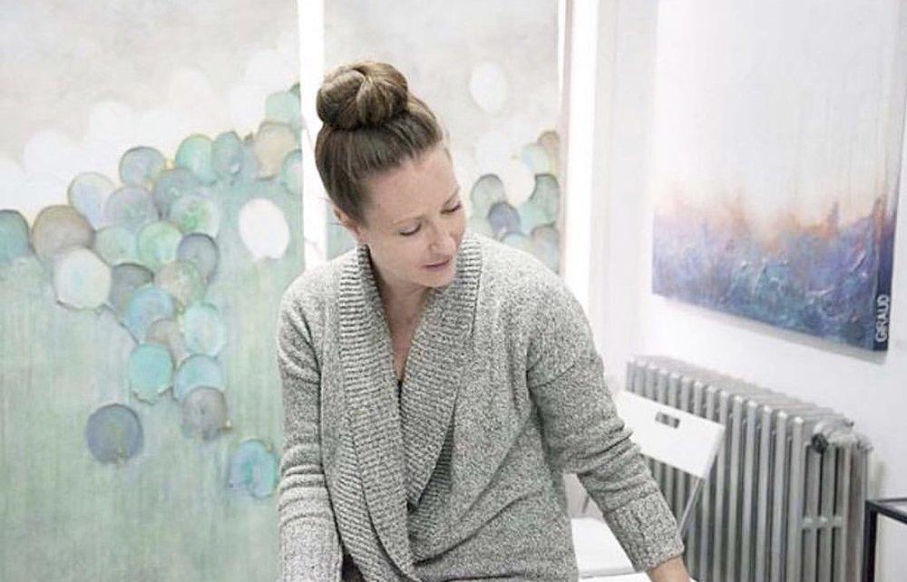 image of Donna Giraud in her studio coaching emerging artists