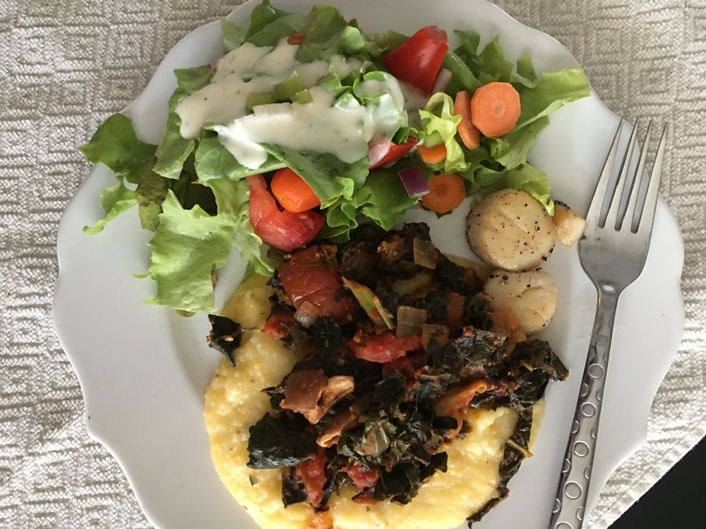 Seared scallops with polenta, sautéed kale and mushrooms, and salad