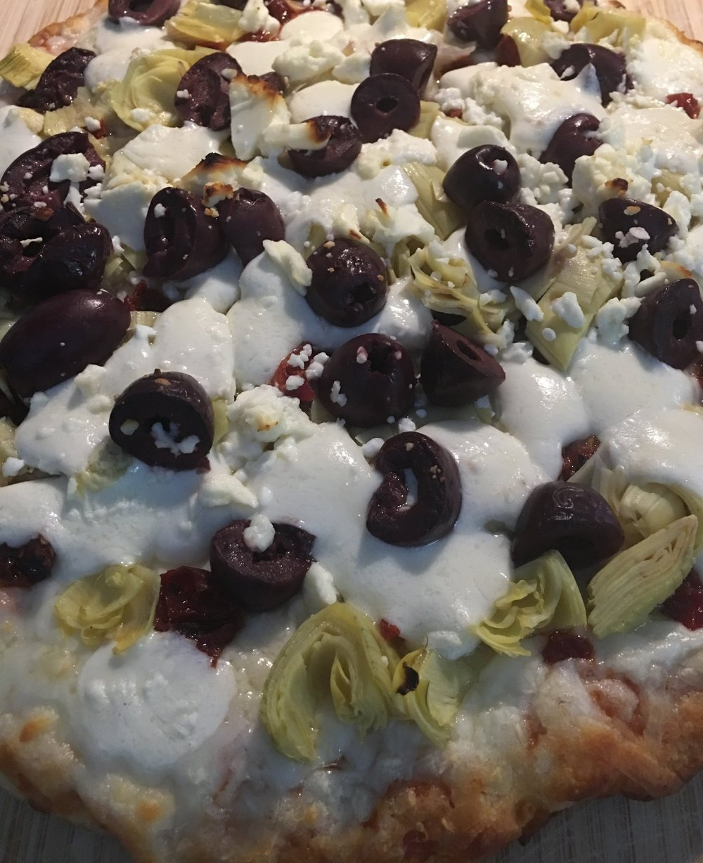 Fancied up Costco pizza with sun-dried tomatoes, artichoke hearts, black olives, mozzarella cheese, and feta. TBH, this was too many toppings and cheese, but we still managed to eat it