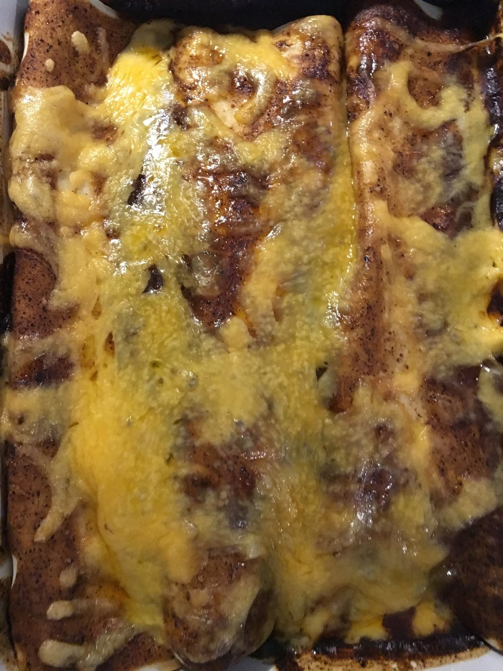 Not pretty AT ALL, but pretty tasty nonetheless. Fab enchiladas with  homemade sauce . I added in a little pureed chipotle in adobo to give it a little extra kick. In an effort to stock the freezer, I quadrupled the sauce recipe and froze a pan of assembled and baked enchiladas.