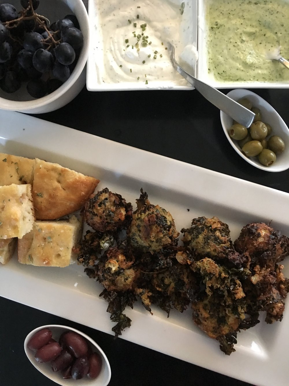 This doesn't look super pretty, but it's crazy delish!  Kale balls  with more focacc, grapes, and kalamata and green olives. The sauces are (left) sour cream + yogurt with Penzey's Brad Street mix and (right) yogurt mixed with homemade basil pesto.