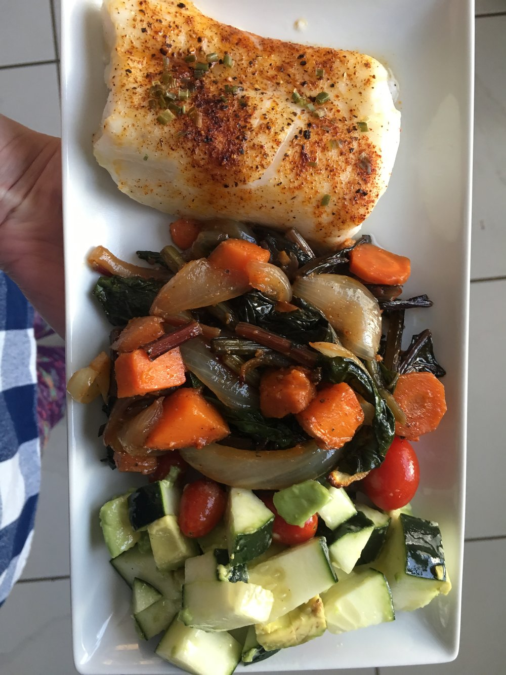 Simple. Healthy. Delicious!   Baked fish with roasted onions, sweet potatoes, carrots, and farmers market beets and greens, plus cucumber and avocado salad