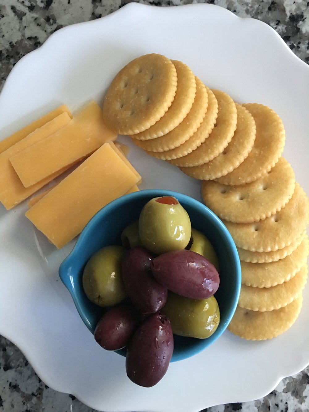 Cheese, crackers, and olives are the perfect when the lazies strike!