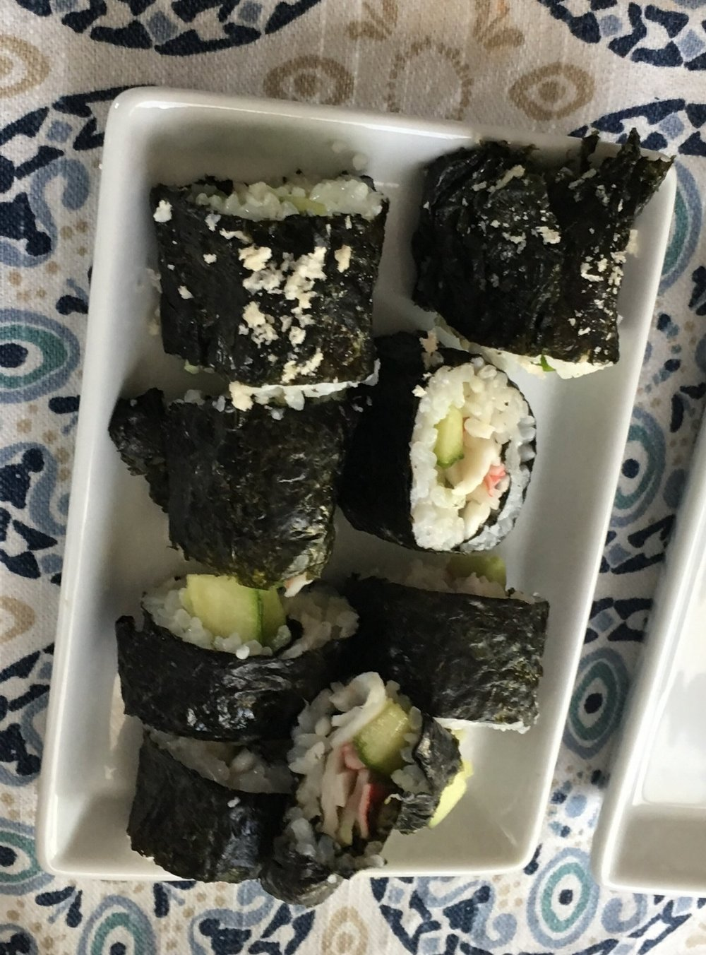 This is not terribly pretty, but it tastes good! I'm getting better at my sushi rolling. We had family over and for about $20 of ingredients, we had enough sushi to feed everyone. Much less than any cheap sushi joint.