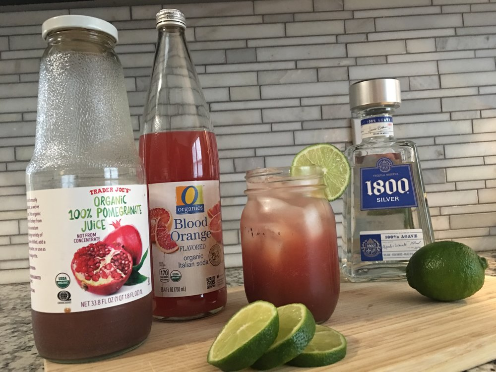 - This is my current go-to bev. Most days, it's a mocktail, but occasionally I like to add a splash of tequila (stop judging me, Charlene).Put ice in your glass, fill up one third of the way with pomegranate juice, top with Italian soda (Trader Joe's lemon is my favorite), squeeze a wedge of lime, and then a splash of tequila if you're feeling feisty. Enjoy!