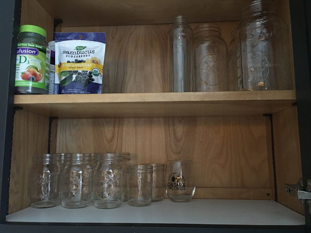 A newly organized glass cabinet. Thanks, honey!