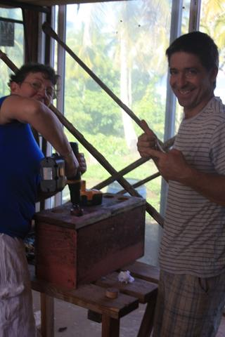 Lamorna and Jonathan preparing a Swathmore box, ventilating the bottom