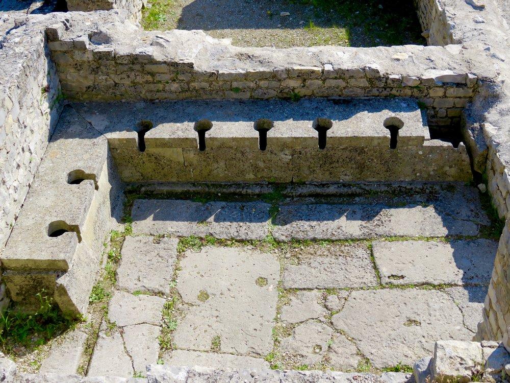 Flush toilets (Roman-style)...comfort not guaranteed!