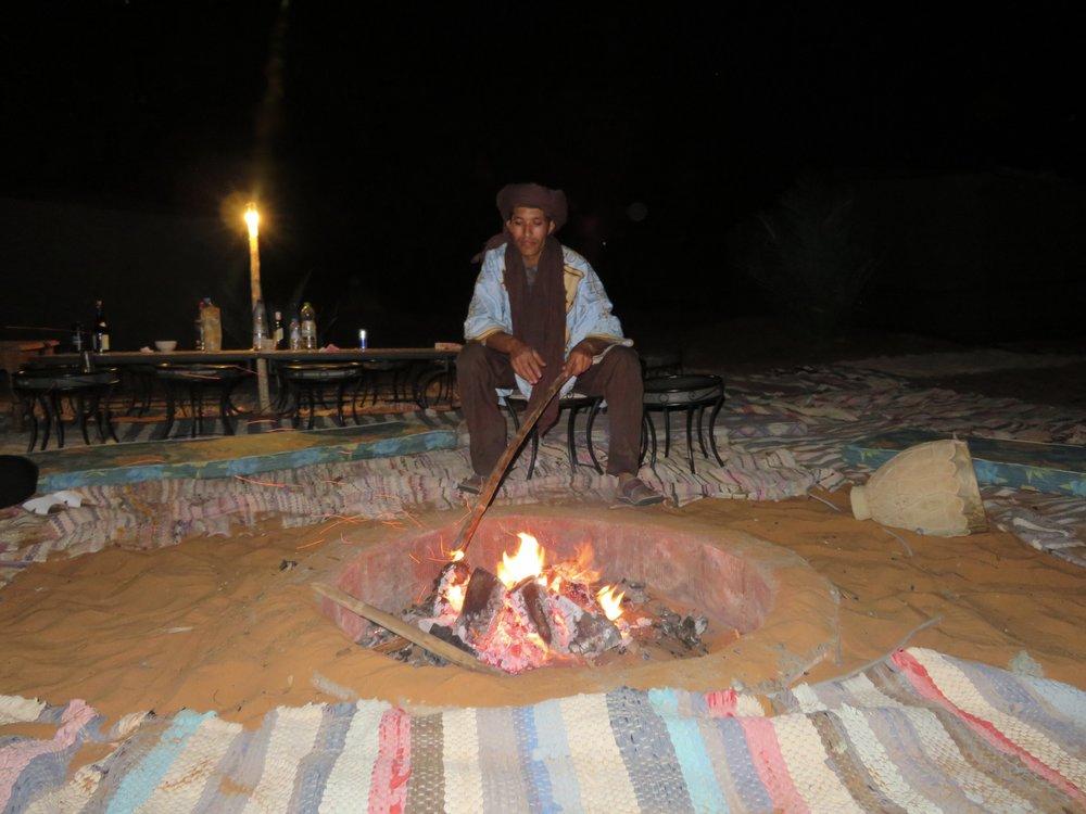 Berber tending our fire