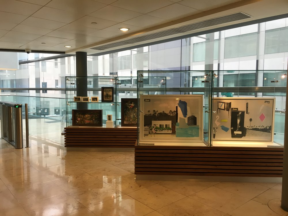 The exhibition cases at the top of the escalators