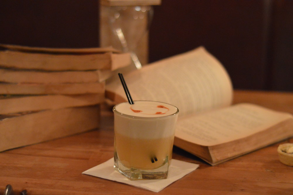 Featured Cocktail: Whiskey Sours . One can feel right at home when reading a book at the Lighthouse. Especially with one of Oxford's most extensive cocktail lists to keep one company.