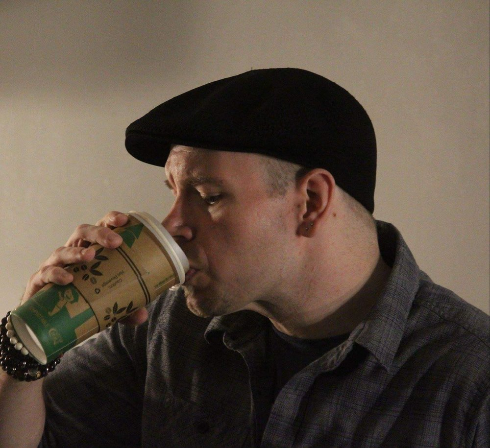 The Carlton is a Performance Poet originally from Upstate NY that cut His poetic teeth the day He realized Morrissey, Comic Books and PT Barnum might be better creative influences than Robert Frost, Pablo Neruda and Emily Dickinson.  While most poets were scrambling to be published by cool alt. Lit publications and small press publishers, The Carlton was getting sponsored by a board game cafe in Northeast Pennsylvania. His first chapbook,  #%$&ing Rockstar , is available pretty much wherever you can find The Carlton.  Currently, you can find Him living in The Poconos trying to figure out how He can sell enough copies of His book to buy another pair of new sneakers or not.