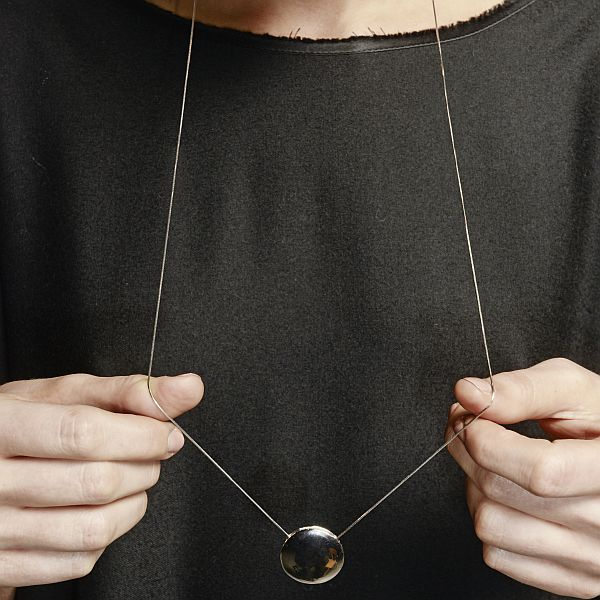 Nedda chain in hands.jpg