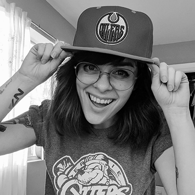 """Meg Smithermanis an artist, podcaster, and novelist turned avid hockey enthusiast. She co-hosts the comedy hockey podcast Shut Yer Five Hole, writes about hockey for GuysGirl.com, and is often touted by strangers on Twitter as """"the reason I got into hockey."""" >> @megsauce"""