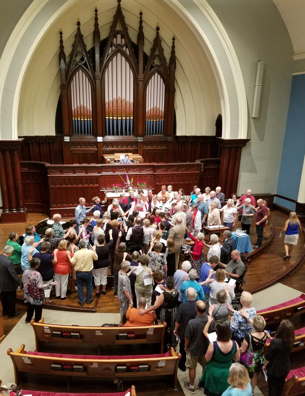 Congregants gather around Rev. Elizabeth during her 2016 ordination at First.