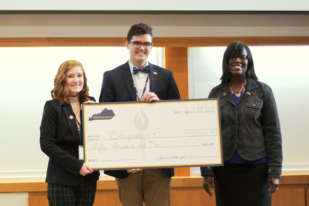 First place team, Bluegrass VR, Claire Harmon and Daniel Sills with Lt. Governor Jenean Hampton.