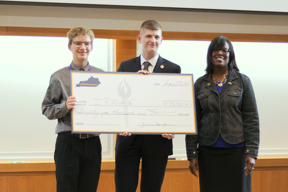 Second place team, I.R.M.A.N., Colin Mooney and Caleb Peterson with Lt. Governor Jenean Hampton.