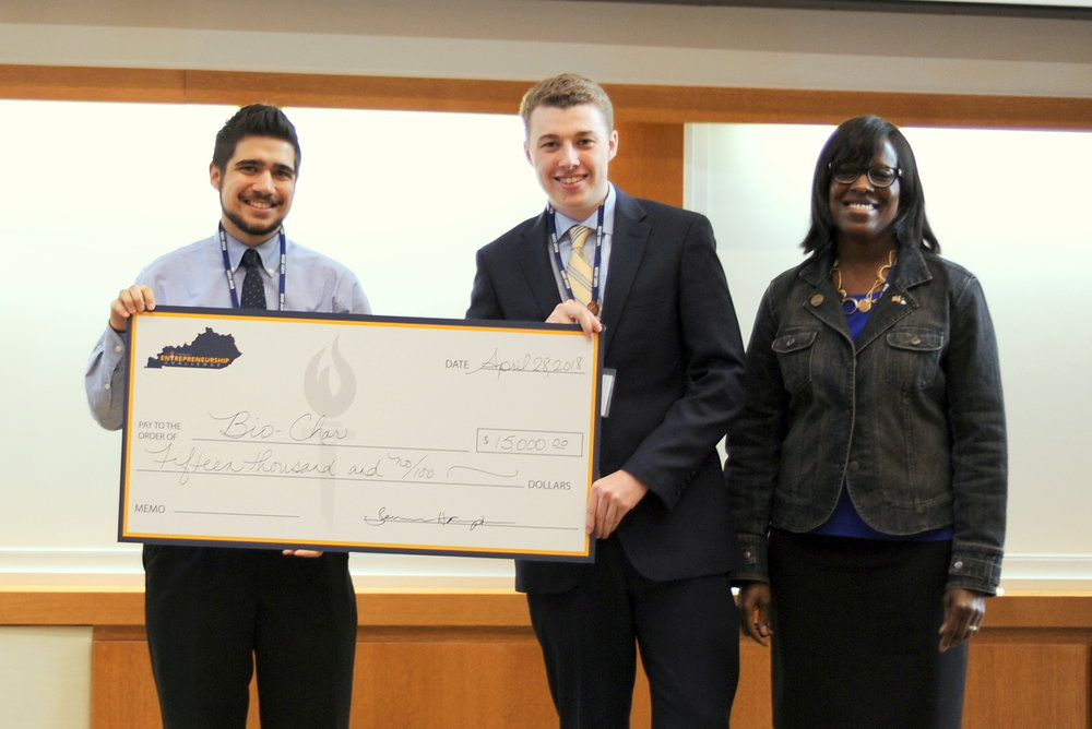 Third place team, Bio-Char, Andrew Gazzaroli and Sam Newman with Lt. Governor Jenean Hampton.