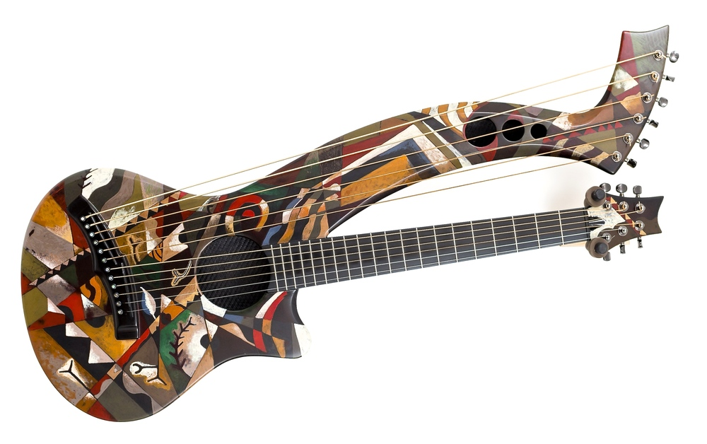 "(above) The ""Modernist"" , artists pigment in shellac on Carbon-fiber harp guitar by Emerald guitars of Ireland…with electronic.s……..18,000.00 #emeraldguitars #harpguitar #artoftheacousticfinish"