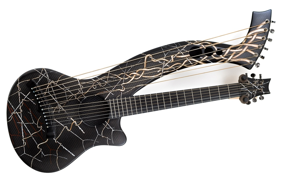 """Ribbon and Zen Sticks"", artists pigment in shellac on Carbon fiber harp guitar by Emerald guitars of Ireland…… #emeraldguitars #artoftheacousticfinish"