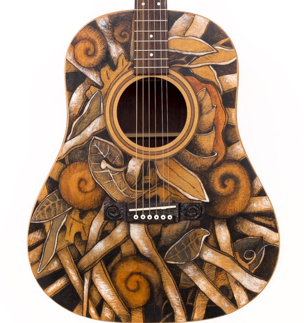 """Ground motif with Ribbon and Spirals""…..Artists pigment in Lacquer…Deep dreadnaught sized guitar, custom made by Peter Cree…Paduak sides and back…Sitka Spruce top….16,000.00"