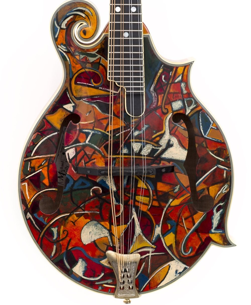 """Abstract motif""….on Michael Kelly mandolin….artists pigment in shellac on sitka spruce top….maple back and sides….. 8,500.00"
