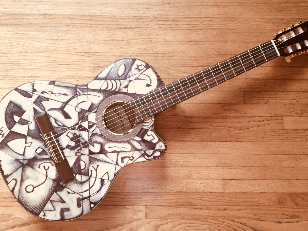 Kremona Rosa Luna , electric acoustic Flamenco guitar.   Black and white lacquer.  Around 4 mils thin.  $2800.00