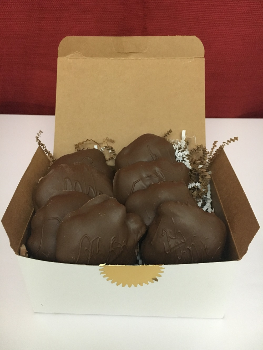 "Pecan + Caramel + Chocolate   AKA ""The Turtle"". Shown here is the 1 pound containing eight of Fat Turtle Confections signature treat.    $28.00"