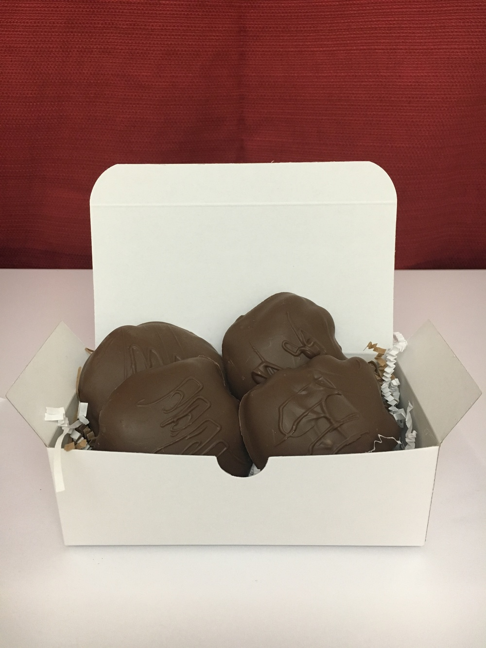 "Pecan + Caramel + Chocolate   AKA ""The Turtle"". Shown here is the 1/2 pound containing four of Fat Turtle Confections signature treat.  $16.00"