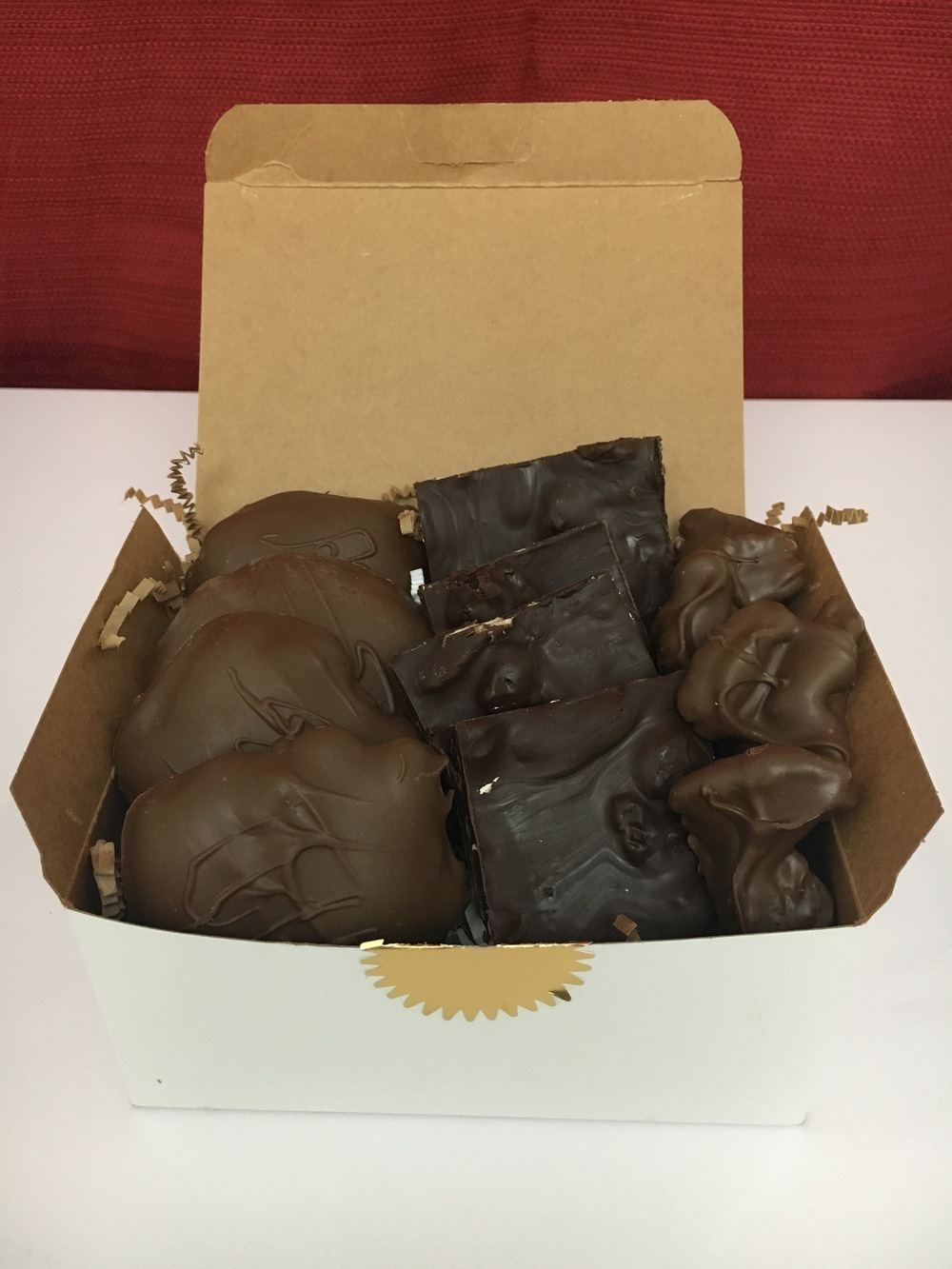 "The Trio    Can't decide what to order? This 1 pound box is perfect for variety lovers! This box features Fat Turtle Confections signature treat of 4 ""turtles"" accompanied by dark chocolate bark and chocolate covered pecans (or other nuts of your choosing). $28.00"