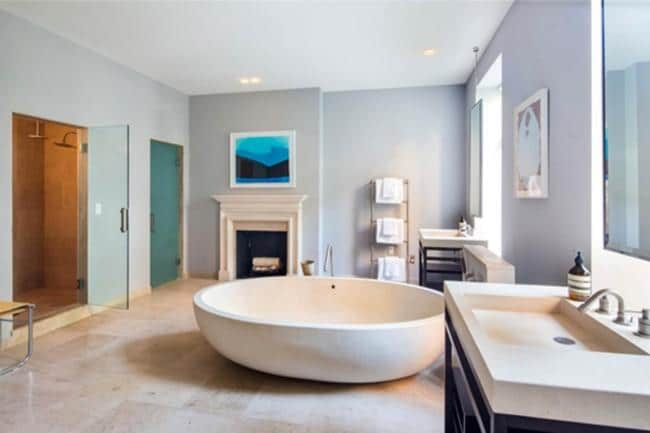 MASTER BATHROOM   The massive freestanding tub is obviously the center of attention in Sarah Jessica Parker's master bathroom. With the size of most New York City studio apartments, the bathroom includes another fireplace, separate vanities and a walk-in shower.