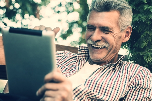 Older man on tablet.jpg