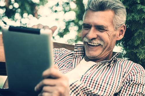 Older man on tablet.jpg