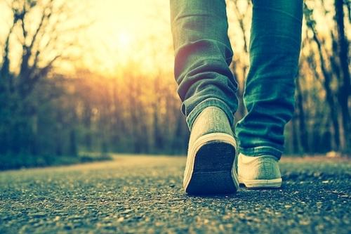 feet of a man walking down the street.jpg