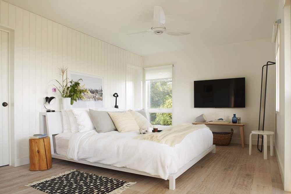mass-cottage-bedroom-white-stained-floors-shiplap-walls-1466x977.jpg